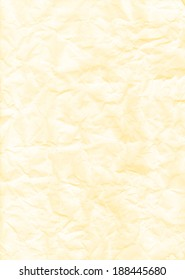 Rough texture of crumpled paper on light yellow
