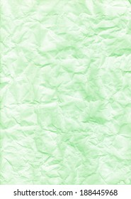 Rough texture of crumpled paper on green