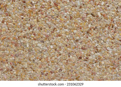 rough texture surface of exposed aggregate finish, Ground stone washed floor, made of small sand stone in light brown color