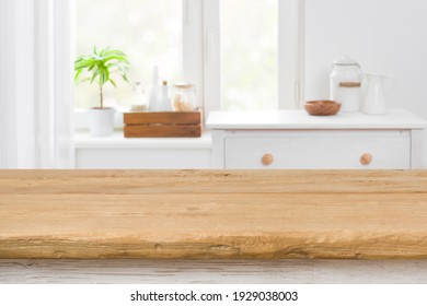 Rough texture table for product display before blurred kitchen window - Shutterstock ID 1929038003