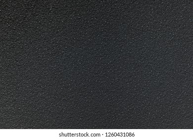 Rough textured black concrete background