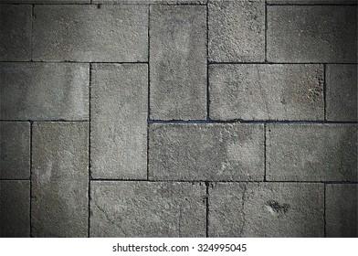Rough textured concrete tiles walkway closeup background
