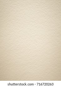 Rough textured light tan art paper background