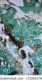 Rough texturized old rusty surface of green, dark blue, white colors. Announcement board