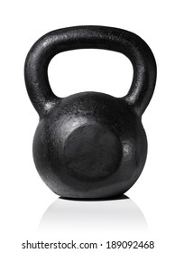 Rough and tough heavy cast iron kettlebell isolated on white with natural reflection.