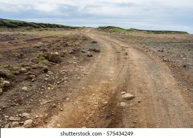Rough unmarked dirt road on the outskirts of Iceland