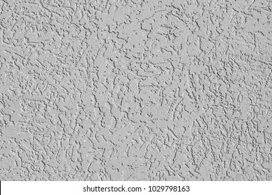 Rough wall texture, wall background, house facade with spatula technique structure. Close up