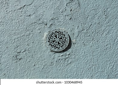 rough wall texture with decorative ventilator