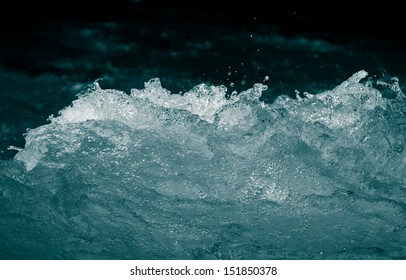 rough water on a black background