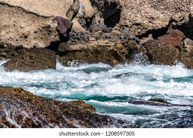 Rough water swirls around jagged, dangerous reef at Santa Cruz Island, providing a glimpse of how nature looks in remote locations
