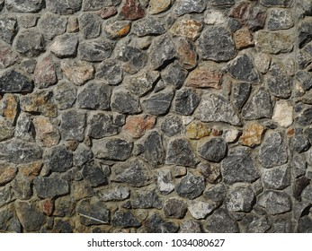 rough weathered abandoned house wall texture surface using finishing technique for concrete cement outdoor use,  in natural light grey colour and mineral stones