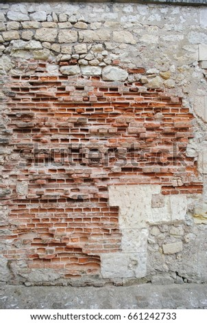 A rough weathered brick wall