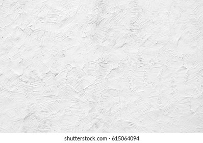 Rough white painted rendering on exterior wall