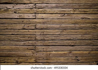 Rough wood plank wall or floor with highlights and shadows