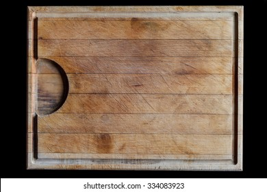 Rough wooden rectangular used cutting board background with horizontal lines and cutting traces directly from above on black background