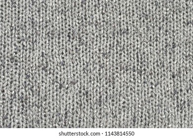 Rough woolen grey knit texture as background.