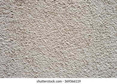 Roughcast on a wall / Roughcast background