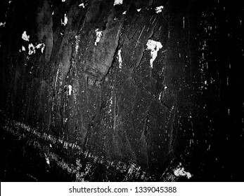 Roughed horror grunge on aged black cement wall surface texture