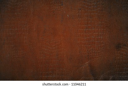 A Roughened And Distressed Piece Of Brown Faux Crocodile Leather Book Cover For Use