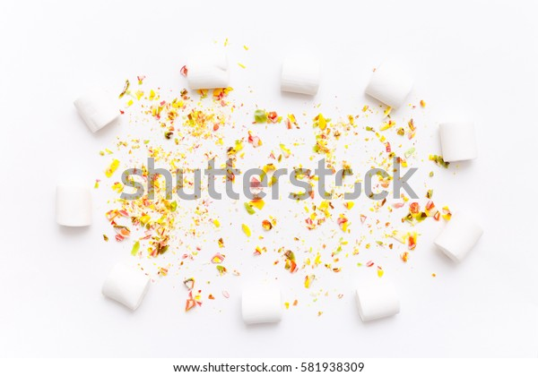 Roughly broken lollipops, candy on colorful white background, top view flat lay. Sweet sucker, lollipop, candy, isolated minimal concept above decoration, food background