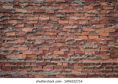 roughly cemented red brick wall