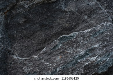 Roughly surface, black granite stone texture background