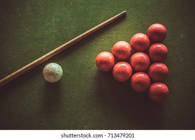 Roughly used Snooker Table with Red Balls, Cue and Stick