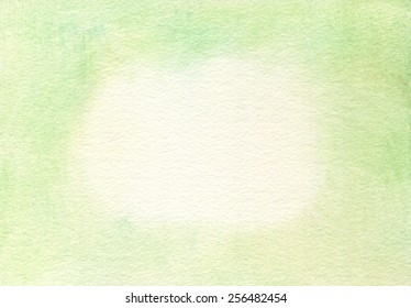 Rough-textured, fibrous, hand-painted light green watercolor paper background.