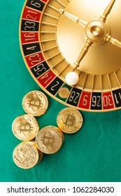 Roulette casino with bitcoins on the green table