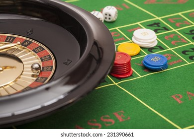 Roulette in casino ,chips and dices stacking on a green felt