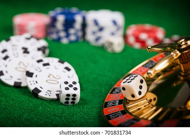 Roulette in casino and Poker Chips.Concept about entertainment and gambling.