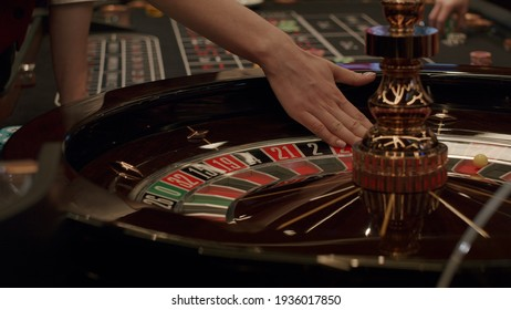 Roulette players place their bets
