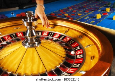 Roulette wheel and croupier hand