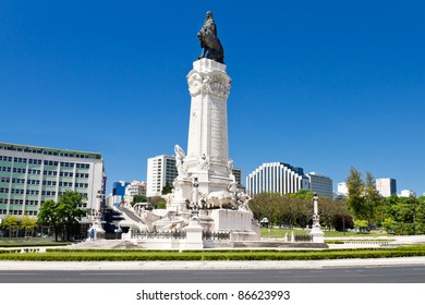 round about enclosing famous Marques do Pombal statue with lion and square in Lisbon, Portugal