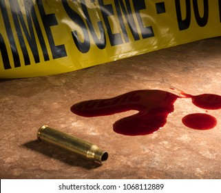 Round from an assault rifle with assault tape and blood on the floor