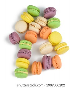 round baked multi-colored almond flour cakes macarons, dessert isolated on a white background, close up