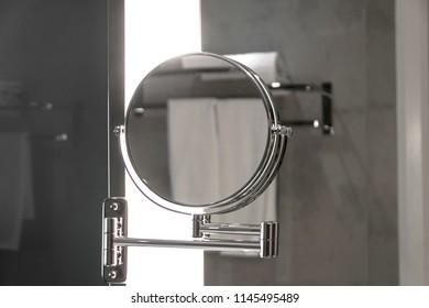 Round bathroom mirror on shaving mirror