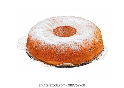 Round biscuit cake on plate, isolated on a white background