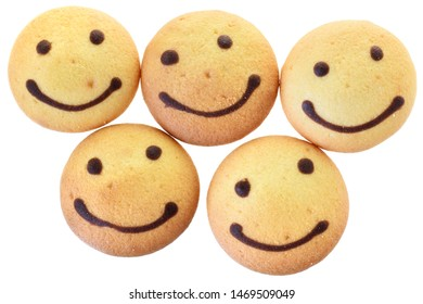 Round biscuit with smile image top view isolated on white background.