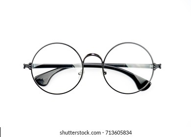 Round black eyeglasses top view on white background.
