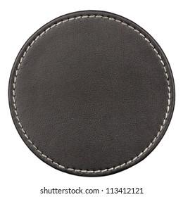 Round black leather table coaster isolated on white