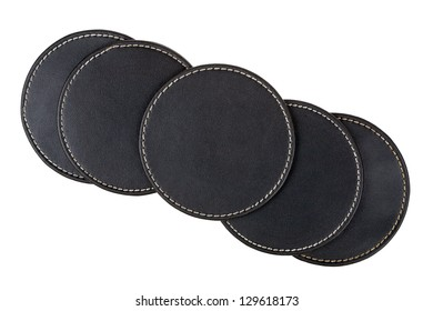 Round black leather table coasters isolated on white