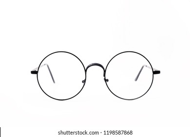 Round black-rimmed glasses are located frontally on a white background. Isolated.