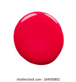 Round blot of red nail polish isolated on white background