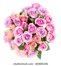 round bouquet of pink and violet  fresh roses closeup  isolated on white background