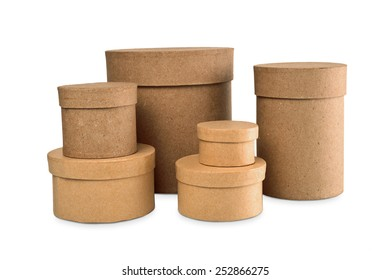 Round boxes for storage of various sizes on a white background