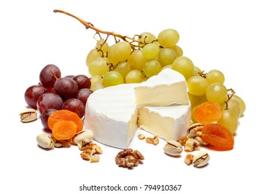 Round brie or camambert cheese and grapes on a white background