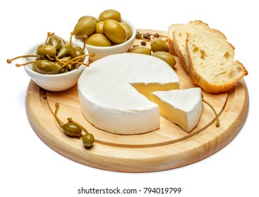 Round brie or camambert cheese on cutting board white background