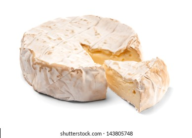 Round Brie cheese with a section cut out over white