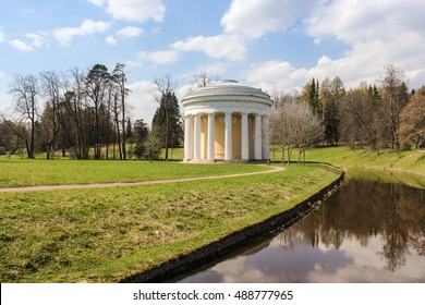 Round building with columns. Spring Nature in Pavlovsk Saint Petersburg park.